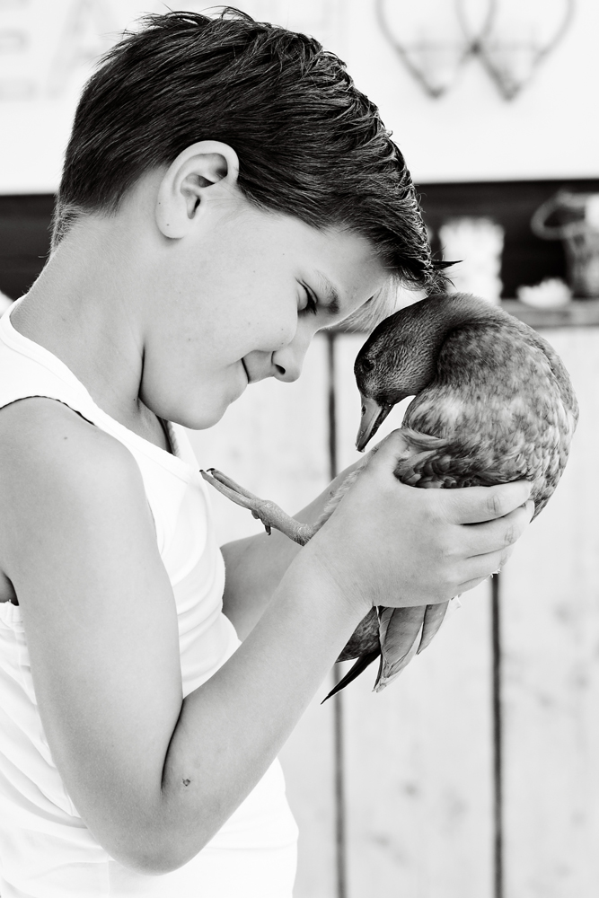 Boy with his pet duck