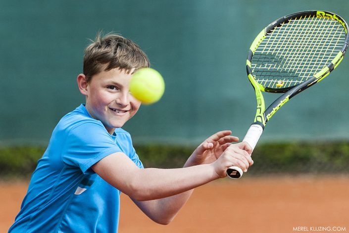 Kyvan playing tennis with eye on the ball