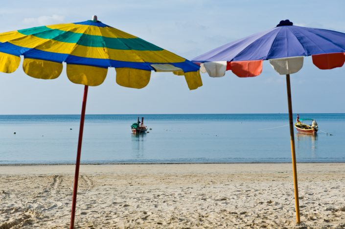 perfect beach with two parasols