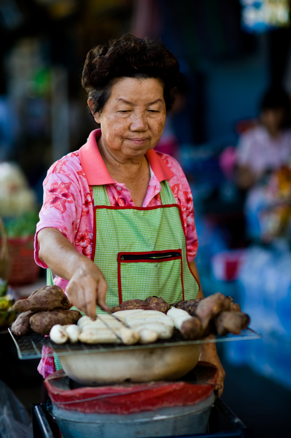 thailand woman making streetfood baked bananas