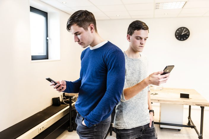 two young entrepreneurs with smartphones