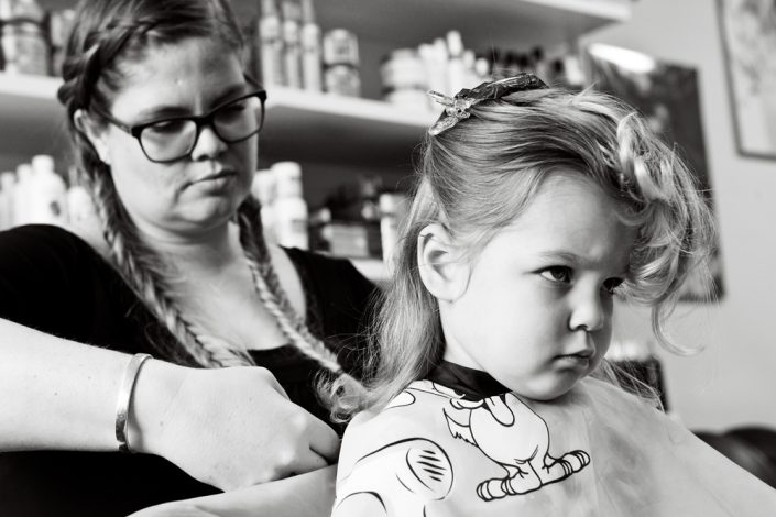 little girl getting a haircut