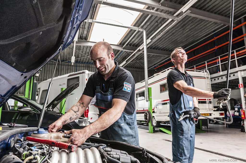 Mechanics working in Car repair shop