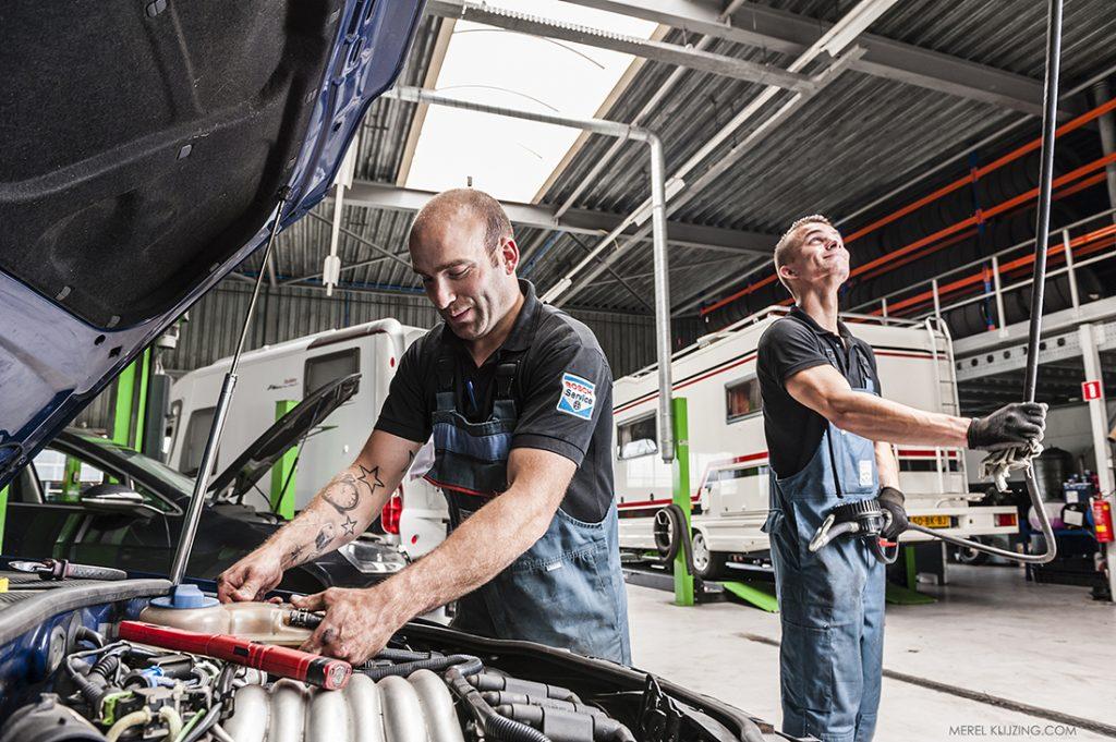 Mechanics working in Car repair shop
