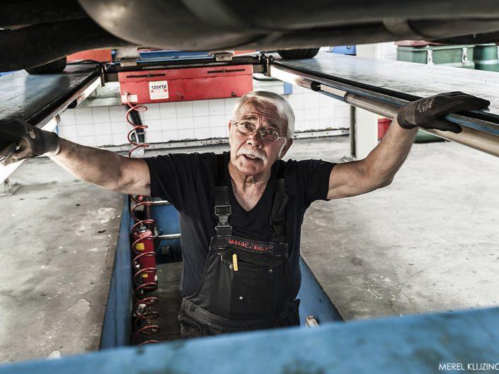 Mechanic working in Car repair shop