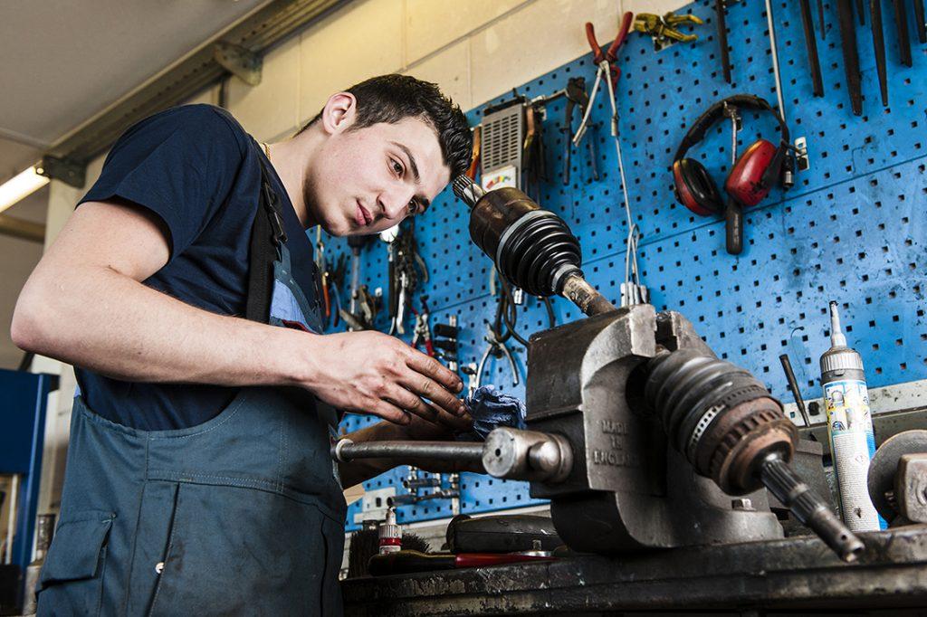 Car repair shop mechanic at work